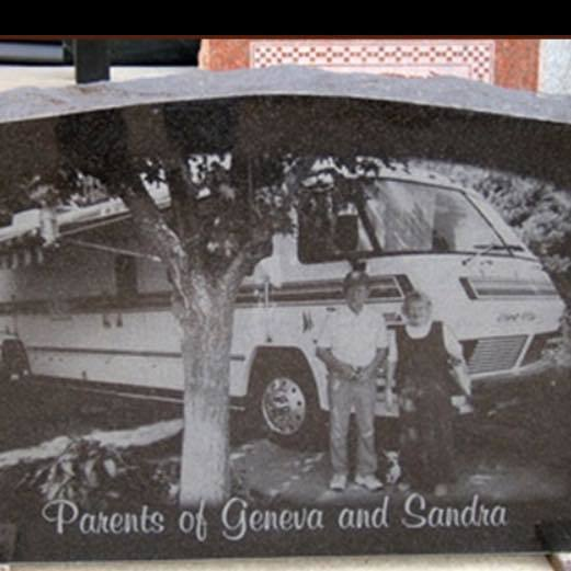 [Image: This custom memorial features a full image of the family photo. ]