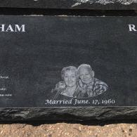 This custom monument features the names as well as photo.